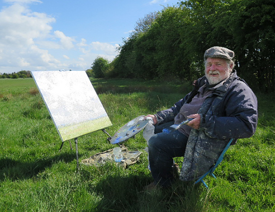 photo of Malcolm Ludvigsen painting in a Yorkshire field