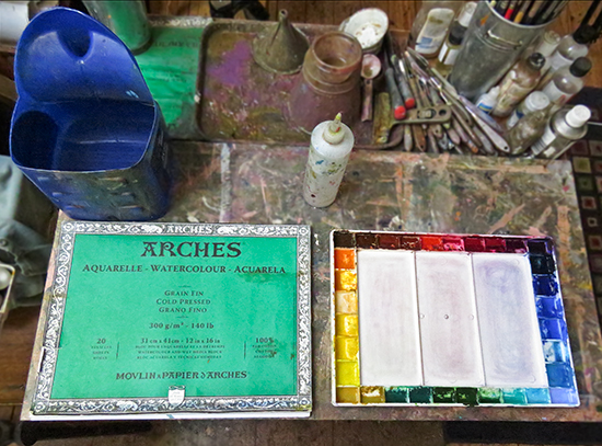 photo of watercolor palette and Arches paper block. © J. Hulsey