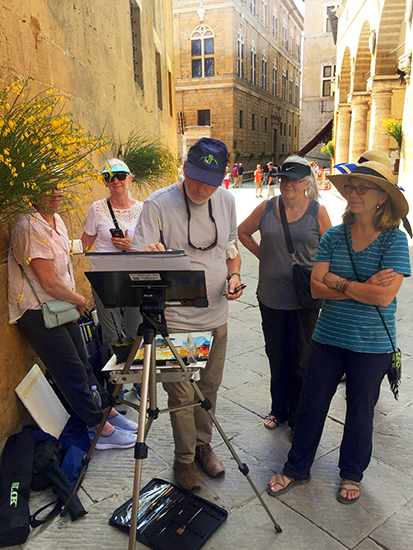 Photograph of John Hulsey Demonstrating Watercolor in Pienza © A. Trusty